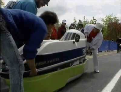 university crew works on car